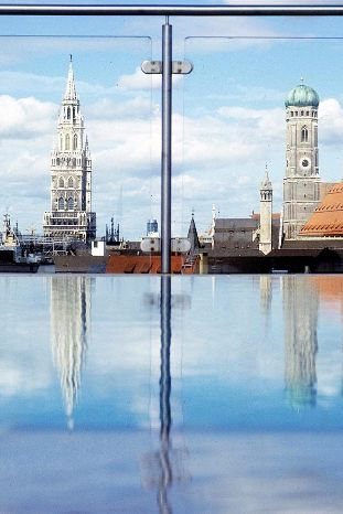 Great The hotel us rooftop infinity pool presents a stunning contrast of modern and Old World Munich