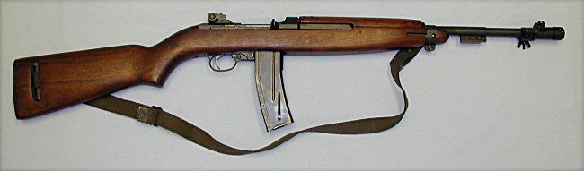 m2   M2 carbine, a select-fire modification with enlarged, 30-round ...