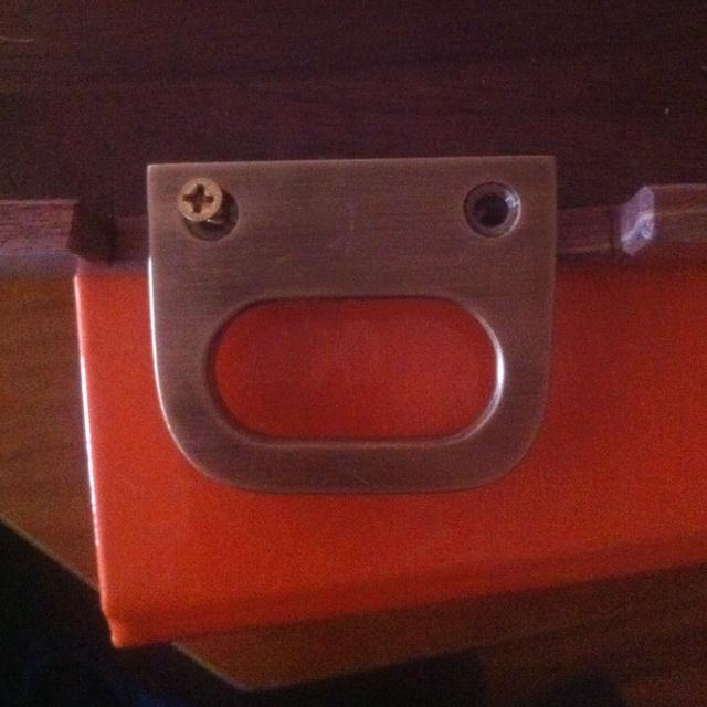 Brass handle on a walnut tray