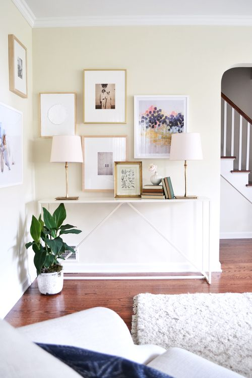 white consol table + bright gallery wall | rehabitat