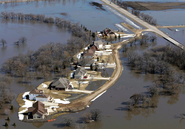 Just last fall, the reservoirs and rivers here in the Red River Valley were so low from drought that Mayor Dennis R. Walaker of Fargo was concerned that the faucets and shower heads in his city would run dry. Now, Fargo residents are bracing for water that is expected to come rushing over those once-parched riverbanks.