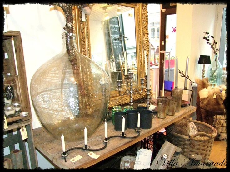 large glass bottle and antique mirror