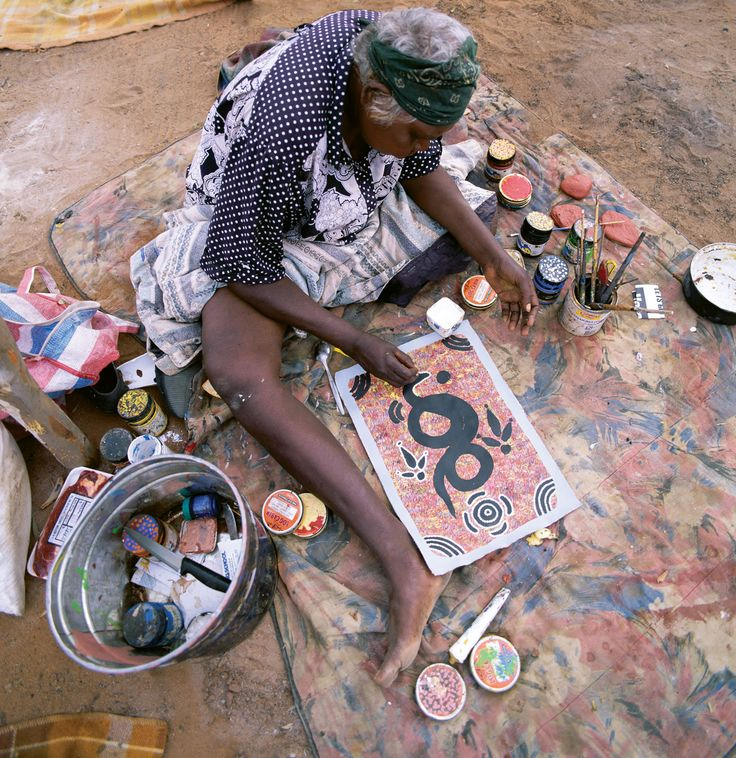 Woman working on a painting, Alice Springs, N. Terr., Steve Vidler/SuperStock
