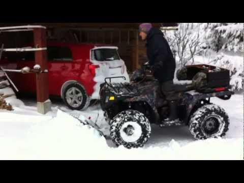 Polaris Sportsman 500 EFI Glacier Snow Plow  My father is using his Polaris Sportsman 500 EFI – 2008 to take care off the snow at the yard a lovely winter day in Sweden The ATV equipped with a Polaris Glacier 52″ plow blade The ATV in the film is not using snow chains. It uses the...