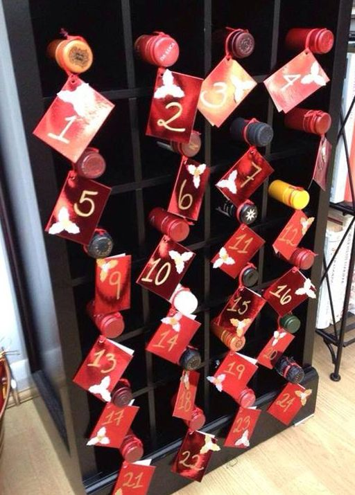 Adult Advent Calendar — Great Christmas decoration idea for our 24-bottle wine cabinet in December!