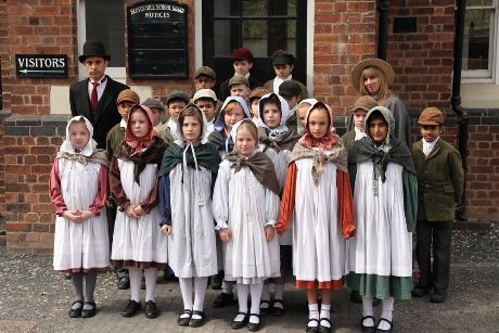 A group of children dressed up in Victorian clothese at Blists Hill.