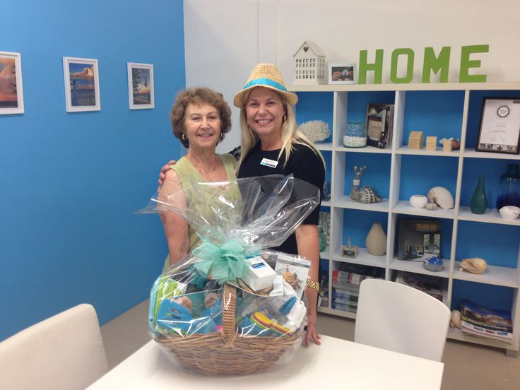 """Congratulations Lydia for winning the """"Tastings on the Hastings"""" hamper compliments of Coast Front Realty"""