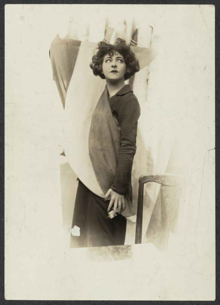 Madame Alla Nazimova, the great Emotional actress, picks up the Purple White & Gold Banner of the National Woman's Party in token of her Allegiance to Equality for men and women. Mme. Nazimova has just become a Founder of the Woman's Party. | Library of Congress