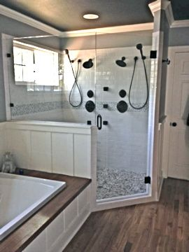 The custom shower is set up spaciously for two people, incorporating two shower head units with hand-held sprays, three body sprayers for the neck, upper back and lower back, a clear glass window that can be opened for fresh air, light, and viewing, and frameless glass so it can all be seen. www.remodelmm.com
