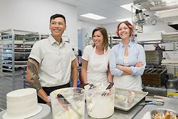 Laughing pastry chefs in commercial kitchen