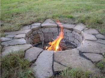 "Only cost $42 to make! Dig a 2ft deep hole four feet around. Purchase 25 4x4x12 pavers and 12 flagstone pavers. Put two bags of 3/4"" river rock in the bottom."