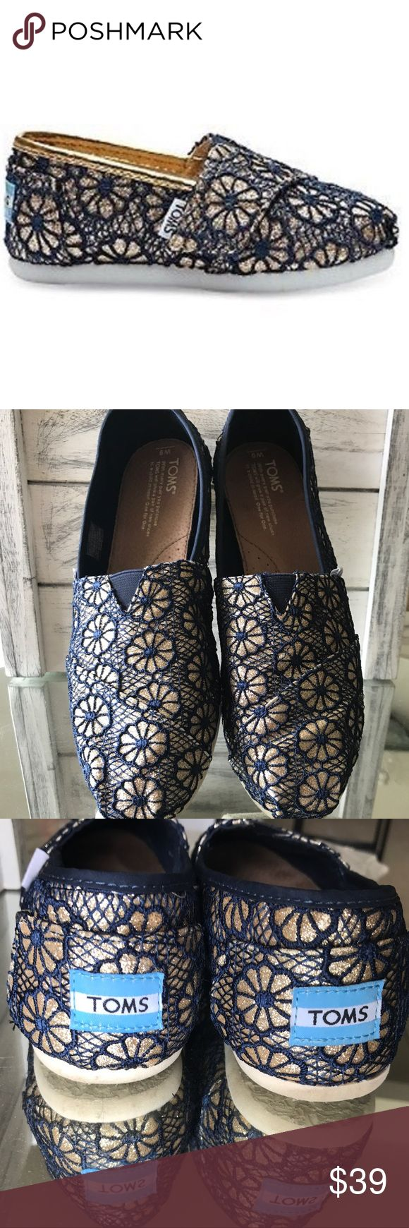 Navy & gold sparkle lace TOMS sz9 The shoes have barely been worn come from a smoke free home are in Great condition see photos for closer details if you need more photos or a measurement of any kind please ask I'll be happy to provide Toms Shoes Flats & Loafers