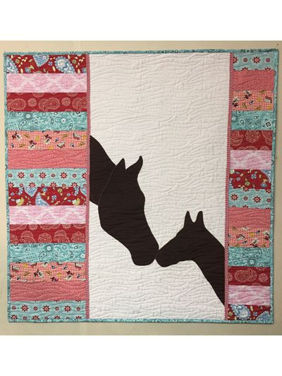 The perfect pattern for your little cowgirl or cowboy! Mare and Foal silhouette applique pieces are printed to full size for ease of use. Simple instructions are illustrated with actual pictures. Scrap or fabric quarter friendly quilt design!Finished...