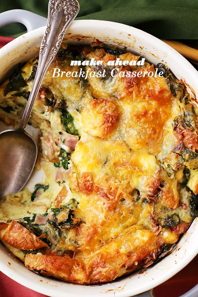 Make Ahead Breakfast Casserole - Easy to prepare, make ahead breakfast casserole chock full of hearty bacon, ham, cheeses and spinach. Prepare this the night before and just pop it in the oven in the morning. Warm, cheesy and delicious!