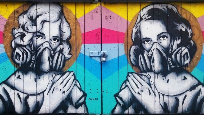 Street Art London. French artist Zabou has a distinct style to her work & often incorporates the spray mask to her murals. Brick Lane, Shoreditch, London, UK. Taken July 2015.