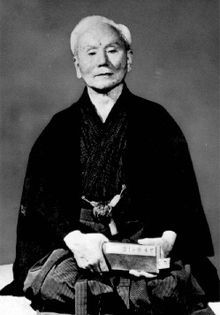 """Gichin Funakoshi (船越 義珍 Funakoshi Gichin?, November 10, 1868 – April 26, 1957) is the founder of Shotokan Karate-Do, perhaps the most widely known style of karate, and is attributed as being the """"father of modern karate"""". Following the teachings of Anko Itosu, he was one of the Okinawan karate masters who introduced karate to the Japanese mainland in 1922. He taught karate at various Japanese universities and became honorary head of the Japan Karate Association upon its establishment in…"""