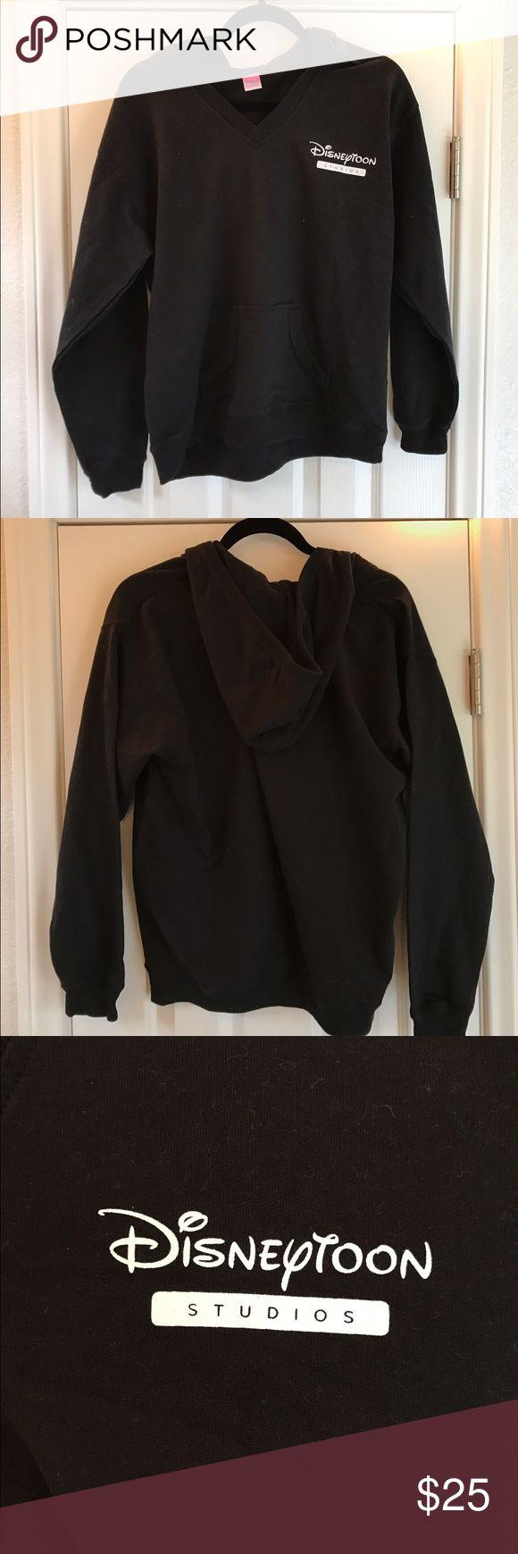 Disneytoon Studios Hoodie Black Disneytoon Studios pullover hoodie, never worn. Disney Tops Sweatshirts & Hoodies