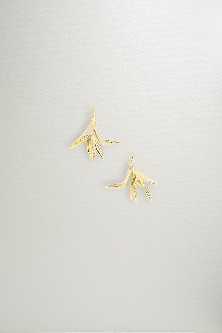 Photographer: Leo Bieber, featuring the Bird of Paradise Earrings. The Bird of Paradise Earrings inherits its name from the tropical crane flower. Delicately set with 0.14 tct natural pavé-set diamonds in 18k Fairtrade gold.