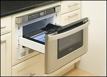Built-in Microwave drawer... This is what we have, I will never go back to the door...