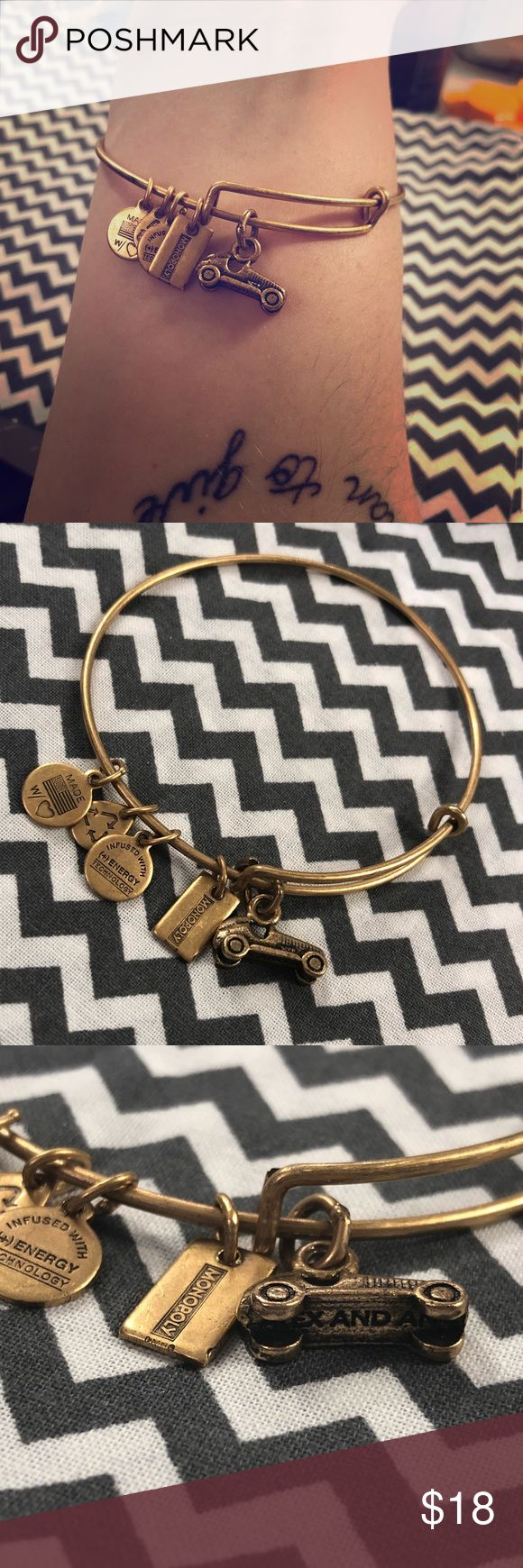 Alex & Ani gold tone Hasbro Monopoly car bangle NWOT Alex & Ani special edition Hasbro Monopoly line bangle bracelet with Monopoly car. Alex and Ani engraved on the bottom. Some tarnish from sitting in my jewelry box, but it just adds to the typical naturally antiqued look of gold toned A&A pieces. Alex and Ani Jewelry Bracelets