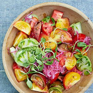 Make the most of juicy summer tomatoes with a bright and colorful salad topped with quick pickled red onions.