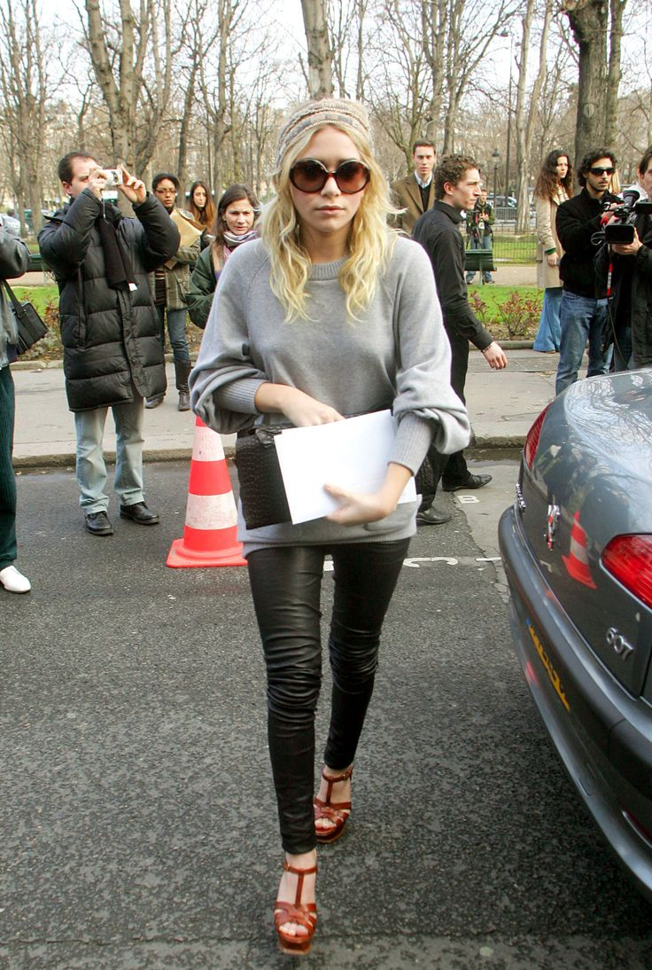 Ashley Olsen, black leather pants and casual sweater- love the combo: