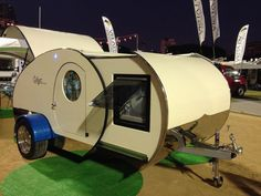 Gidget teardrop camper takes sliding approach to extra space. The slide-out module increases the interior space in the Gidget trailer
