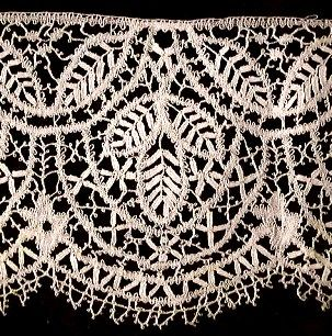 bobbin lace. Lace was Gold in the 1860's, use it sparingly and only use black, cream or white....no polyester, please.