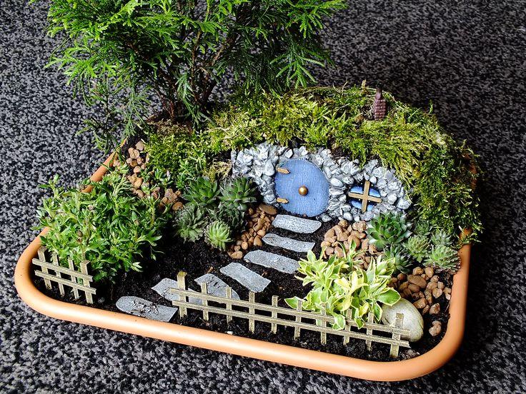 Fairy garden with a little hobbit style house