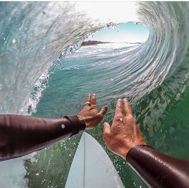 awesome surfing picture going through the tube