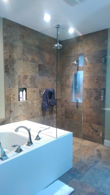 Level entry shower with linear drain. All work by Strait Tile and Stone