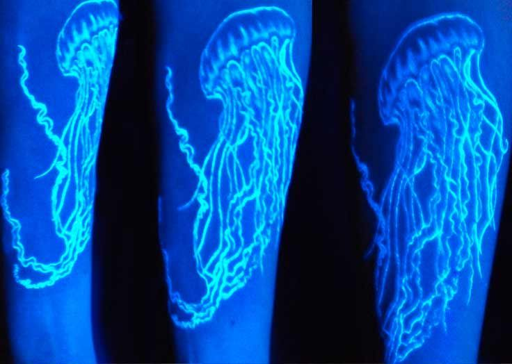 Let a glowing jellyfish pop out from your arm with this black light tattoo!
