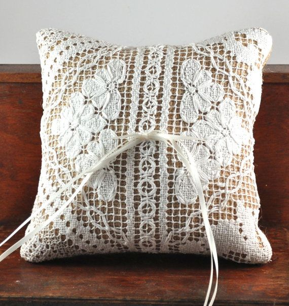 Delightful ring bearer cushion made from hessian/burlap and vintage hand made filet lace.   4 strands of ivory ribbon cascade from the middle