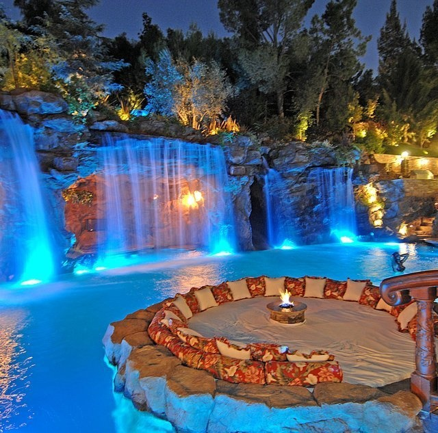 Sand and pillows around a firepit, surrounded by water......yes please!!!