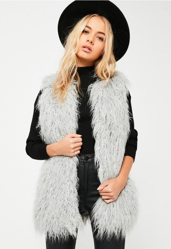 This luxe faux fur gilet in a light grey shade is perfect for adding a chic touch to your daytime outfit.