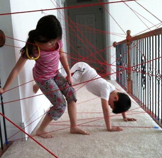 """Make a """"laser grid"""" by taping yarn to the walls and let your kids try to get though it. Also great for parties and laughing at your friends.  I mean really, who doesn't see those lasers on tv and think it would be fun to try…"""