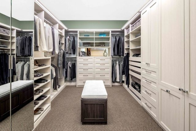 Love The Bench Seat In The Middle Of This Walk In Closet The Shaker Cabinet Style Is Timeless Custom Closet Cabinets Home Custom Closets