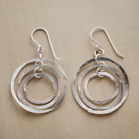 MOBILE HOOP EARRINGS - Taking their cue from modernist mobiles, the hand-hammered sterling silver rings in these mobile hoop earrings sway independently, making your every move a work of art.