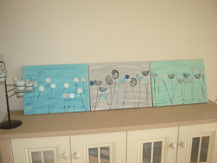 three pictures I painted using potatoe prints and a bottle top.  used canvas's I got at the recycle shop.  they are now hanging in the dining room above the cabinet they are sitting on.