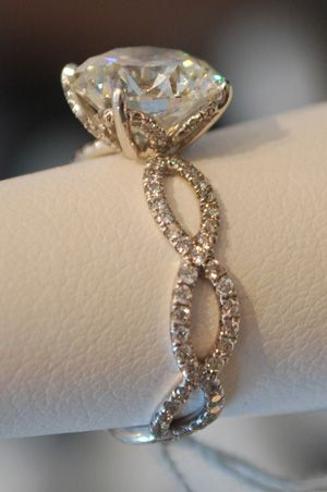vintage and different L O V E!! I am not a fan of the single solitair dimond rings, but I like this one, I love the band! I really want a traditonal (3 dimond ring) But when this day comes I will be happy with what ever my future husband gives me. A gIrl can dream cant she?