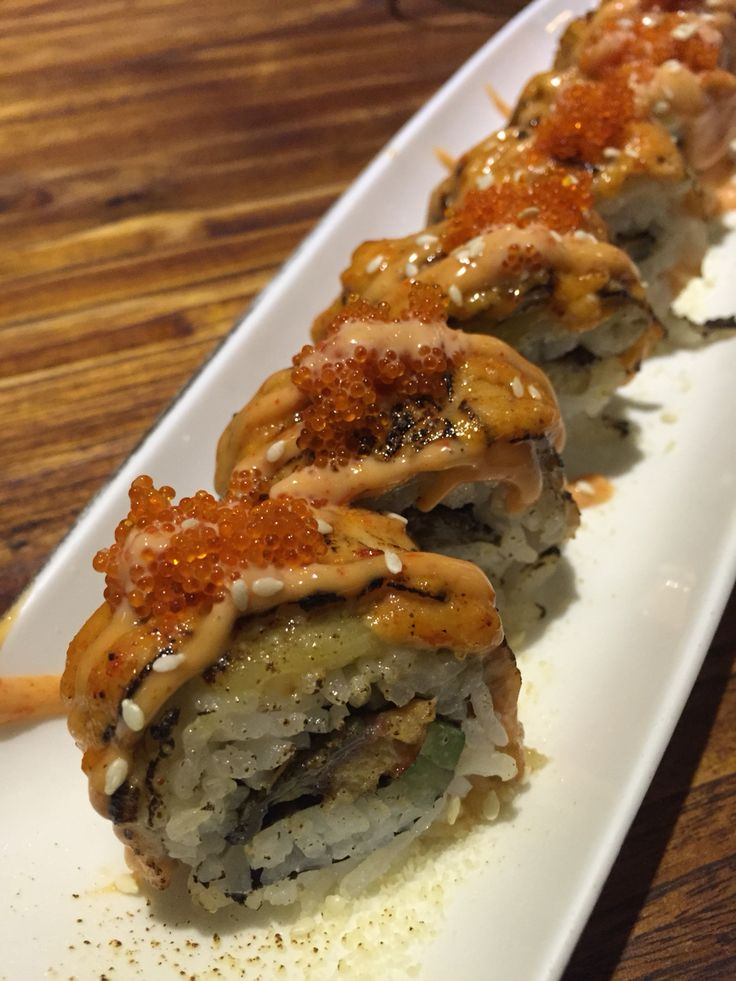 Favorite! Tom & Jerry's sushi, contains with salmon, grilled eel, tobiko (flying fish roe), cucumber, and of course cheese!