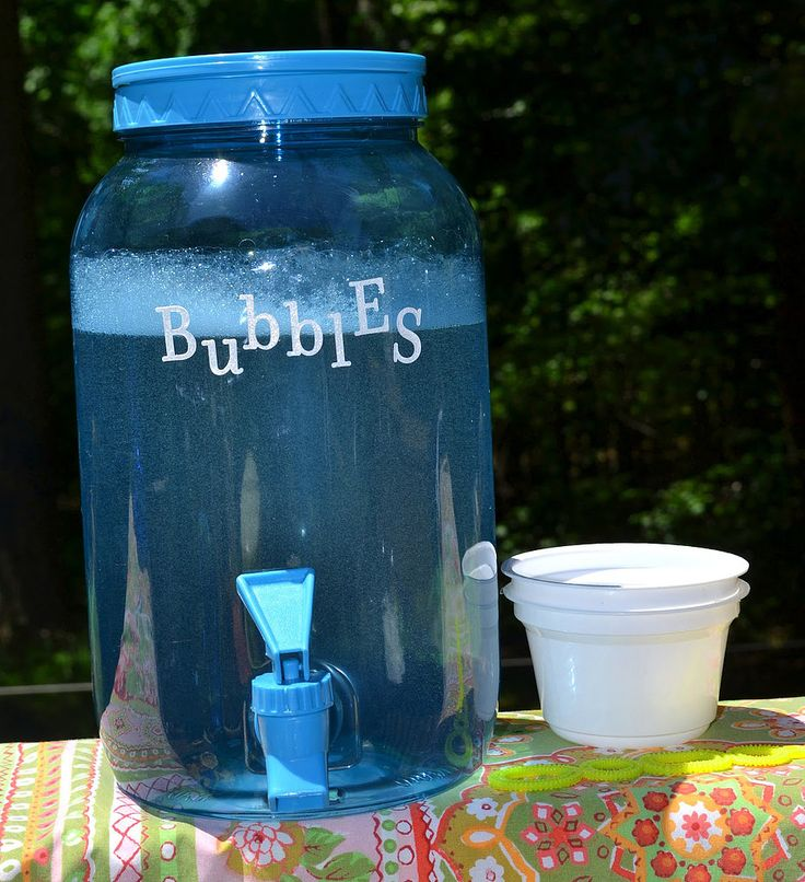 Set Up a Bubble Station: If you're having an outdoor reception, then set up a drink dispenser filled with bubbles. Kids will love it, and just think about the adorable photo potential!  Source: Mrs. Happy Homemaker