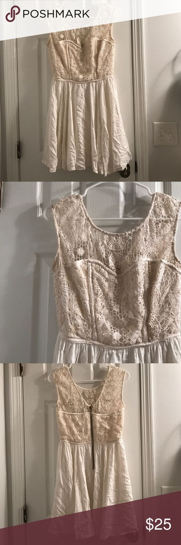 "Beautiful Cream Dress So cute and elegant. You can dress this up or down. Zips in the back. 100% rayon. Worn once for wedding party. Is lined. Length is approximately 32 inches. Fits like a medium. No trades. I am 5'7"" and this comes to a little above my knees (see last pic). GB Dresses"