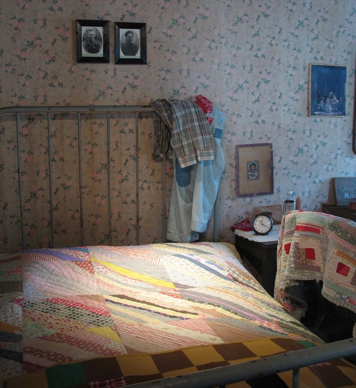 From a replica of Dolly Parton's childhood home. Furnishings are originals. Love this quilt.