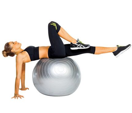 belly buster: Sit on ball and lean back with hands on floor behind you, palms down and turned out, legs extended. Bring right knee toward chest (as shown); return to start. Repeat with left knee for 1 rep. Do 12 reps
