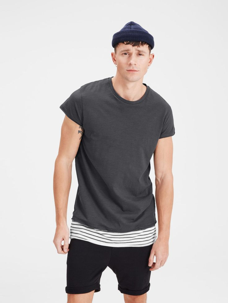 Season must-have: longer line tshirt with striped details, loose fit 100% cotton.