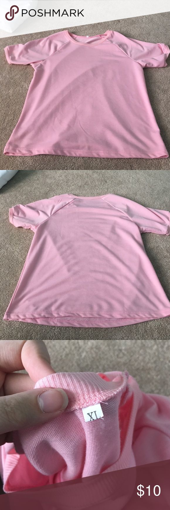 Baby Pink Tee Good condition. Never worn. Purchased from online thrift shop-like thing but didn't fit correctly. No brand listed. *Listed as Urban Outfitters because no brand on tag* Urban Outfitters Tops Tees - Short Sleeve