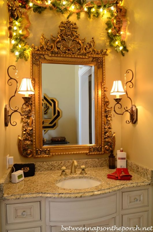 Master Bath Decorated with Lit Garland.  Love the white vanity with granite counter top.