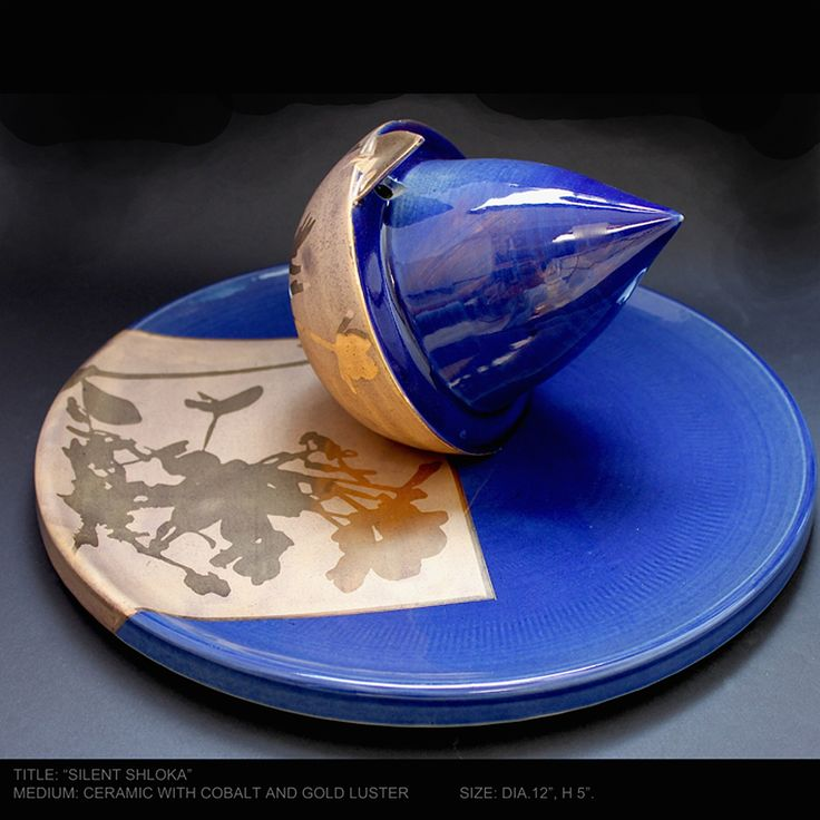 """SILENT SLOKA"" Wheel thrown and altered ceramic  Medium:Stoneware with cobalt glaze and gold lustre Size:12""x5''  Year:2012."