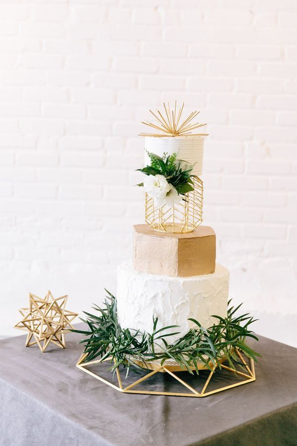 Art Deco minimalistic white, gold and greenery four layered wedding cake